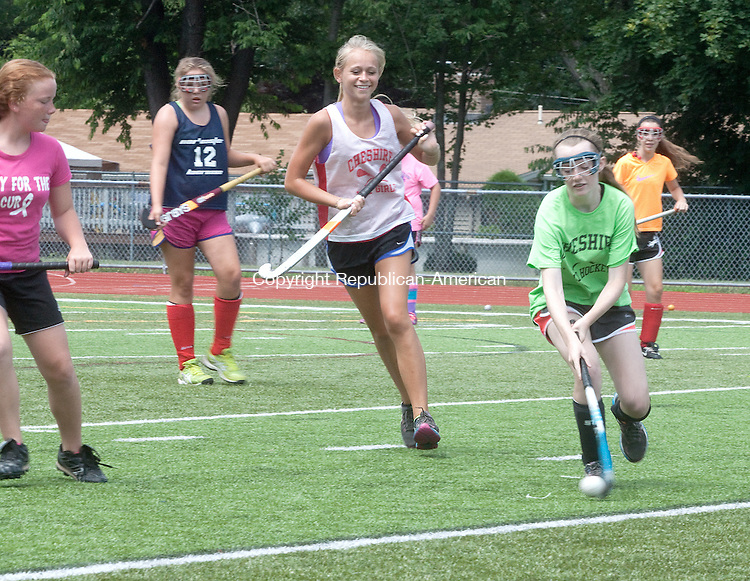 CHESHIRE- JULY 10 2014 070914DA14- Members of the Cheshire Field Hockey team practice their skills during day two of its camp at Cheshire High School on Wedesday.<br /> Darlene Douty Republican American