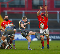29th February 2020; Thomond Park, Limerick, Munster, Ireland; Guinness Pro 14 Rugby, Munster versus Scarlets; Jonathan Evans of Scarlets kicks the ball from the ruck