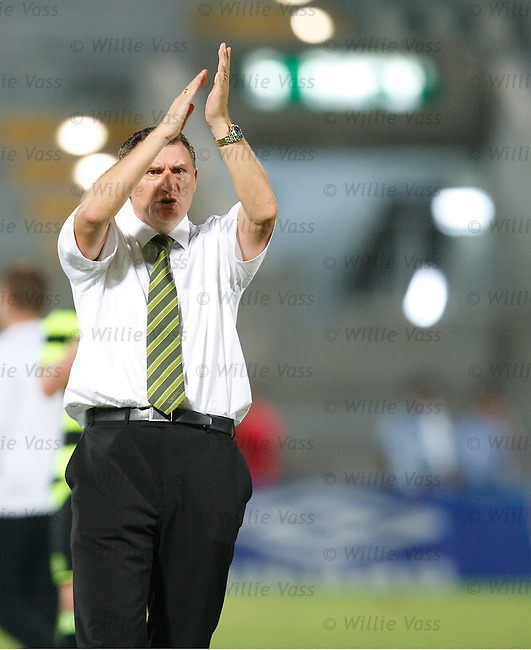 Tony Mowbray applauds the travelling fans at the end