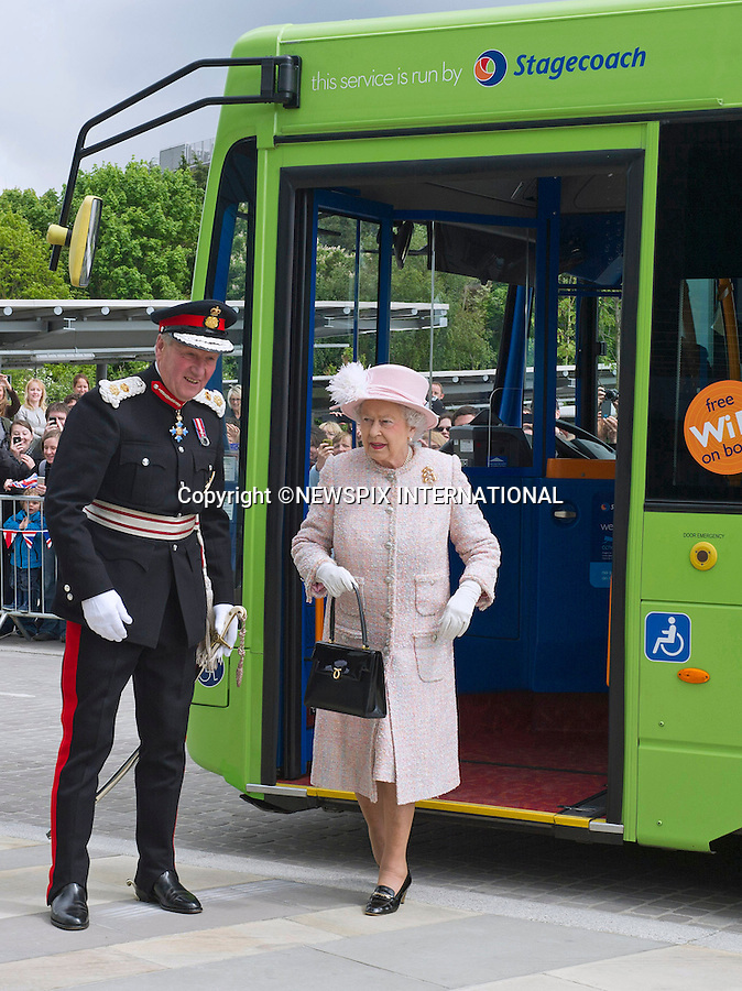 """THE QUEEN GETS ON THE BUS.Her Majesty followed in the footsteps of other Royals and has finally taken a bus ride..Arriving in Cambridge by train the Queen and Duke of Edinburgh took the Cambridgeshire Guided Bus on the world's longest guided busway, a short distance to the Medical Research Council Laboratory of Molecular Biology..Other Royals to have taken a bus ride include Prince Charles, Camilla, Duchess of Cornwall and Prince Harry while in New York..Mandatory Credit Photo: ©Francis Dias/NEWSPIX INTERNATIONAL..**ALL FEES PAYABLE TO: """"NEWSPIX INTERNATIONAL""""**..IMMEDIATE CONFIRMATION OF USAGE REQUIRED:.Newspix International, 31 Chinnery Hill, Bishop's Stortford, ENGLAND CM23 3PS.Tel:+441279 324672  ; Fax: +441279656877.Mobile:  07775681153.e-mail: info@newspixinternational.co.uk"""
