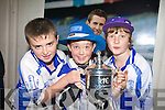 Michael Broderick, Michael O'Connor and ?Greig Curran get their hands on the cup at the Castleisland Desmonds team homecoming in Castleisland on Saturday night