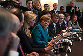 German Chancellor Angela Merkel (C), with Ivanka Trump (left center), speaks during a roundtable discussion on vocational training with United States and German business leaders lead by President Donald Trump (not seen) in the Cabinet Room of the White House in Washington, DC on March 17, 2017.    <br /> Credit: Photo by Pat Benic / Pool via CNP