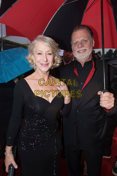 DAME HELEN MIRREN & TAYLOR HACKFORD.Arrivals at the 67th Golden Globe Awards held Beverly Hilton, Beverly Hills, California, USA..January 17th, 2010.globes half length black dress suit couple umbrella beard facial hair .CAP/AW/HFPA.Supplied by Anita Weber/Capital Pictures