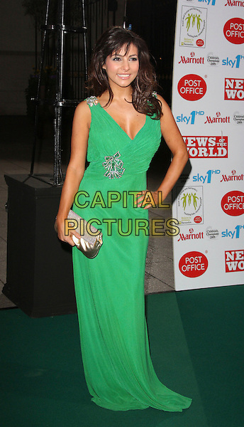 ROXANNE PALLETT .Children's Champions Awards 2009 at the Grosvenor House Hotel, Park Lane, London, England, March 4th 2009..full length green long maxi dress hand on hip silver gold clutch bag sparkly diamante .CAP/ROS.©Steve Ross/Capital Pictures