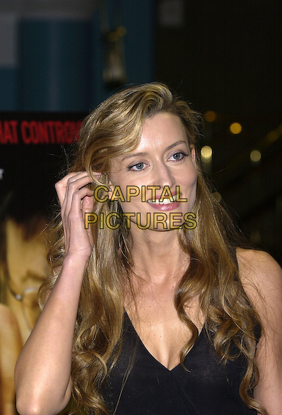 NATASHA McELHONE.At the special celebrity and film industry screening of Farenheit 9/11, Vue cinema, Leicester Square, London,.28th June 2004..portrait headshot long curly wavy hair.Ref: PL.www.capitalpictures.com.sales@capitalpictures.com.©Capital Pictures