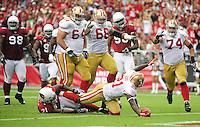 Sept. 13, 2009; Glendale, AZ, USA; San Francisco 49ers running back (21) Frank Gore celebrates after scoring a touchdown in the second quarter against the Arizona Cardinals at University of Phoenix Stadium. Mandatory Credit: Mark J. Rebilas-