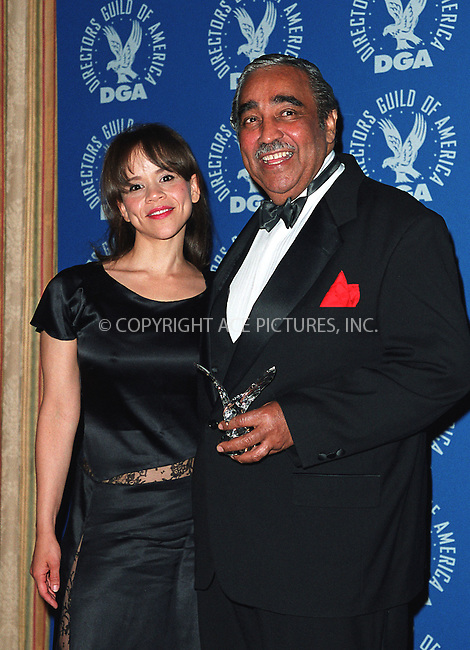 Rosie Perez poses with Congressman Charles B. Rangel (D-NY)  at the Directors Guild of America Honors 2002 at the Waldorf-Astoria in New York City. June 9, 2002. Please byline: Alecsey Boldeskul/NY Photo Press.   ..*PAY-PER-USE*      ....NY Photo Press:  ..phone (646) 267-6913;   ..e-mail: info@nyphotopress.com
