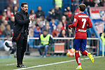 Atletico de Madrid's coach Diego Pablo Simeone (l) with Antoine Griezmann during La Liga match. February 6,2016. (ALTERPHOTOS/Acero)