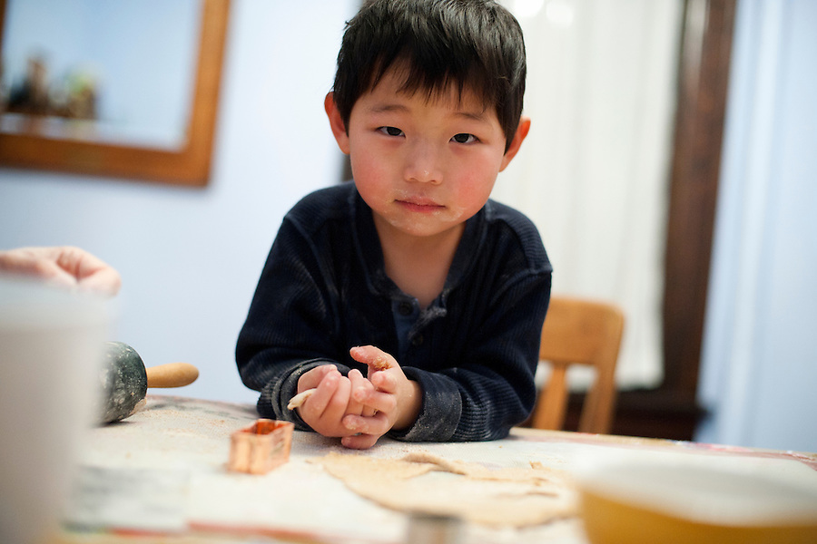 Holden Miller, 3, rolls out dough and cuts cookie shapes while helping his mother, Suzanne Stute, bake homemade dog biscuits at the Miller/Stute home in Madison, Wis., on Dec. 11, 2010.