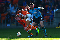Fleetwood Town's Ashley Eastham challenges Blackpool's Kyle Vassell<br /> <br /> Photographer Richard Martin-Roberts/CameraSport<br /> <br /> The EFL Sky Bet League One - Blackpool v Fleetwood Town - Saturday 14th April 2018 - Bloomfield Road - Blackpool<br /> <br /> World Copyright &copy; 2018 CameraSport. All rights reserved. 43 Linden Ave. Countesthorpe. Leicester. England. LE8 5PG - Tel: +44 (0) 116 277 4147 - admin@camerasport.com - www.camerasport.com
