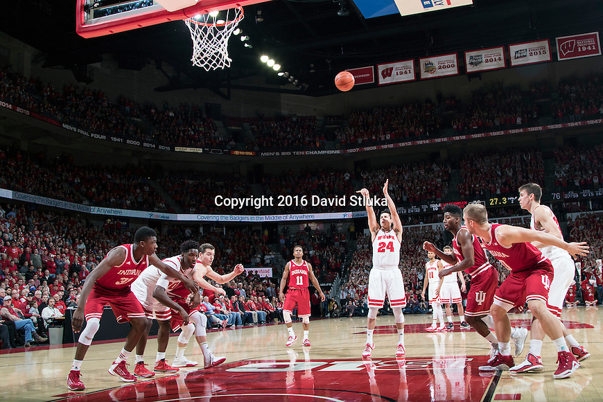 Wisconsin Badgers guard Bronson Koenig (24) shoots a free throw during an NCAA college basketball game against the Indiana Hoosiers, Tuesday, January 26, 2016, in Madison, Wis. The Badgers won 82-79 in overtime. (Photo by David Stluka)