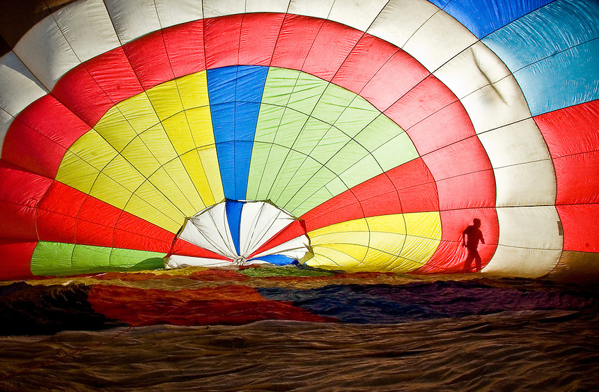 Justin Kinsinger, 24, runs alongside his hot air balloon before takeoff, making sure that it does not have any holes. Kinsinger is a third generation hot air balloonist who is known as the youngest balloonist in the San Francisco Bay Area.
