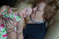 Grandma comforting granddaughter age 70 and 4. Zawady Central Poland