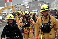 Members of the Fairfax County, Va., Task Force 1 Urban Search and Rescue finished searching the structures and debris and are headed back to base camp on March 17, 2011, in Unosumai, Japan. A 9.0 earthquake hit Japan on March 11 that caused a tsunami that destroyed anything in its path.