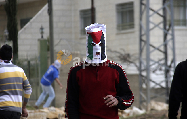 Palestinian protesters throw stones at Israeli soldiers during a demonstration to mark the anniversary of Land Day in the village Kafr Qaddum, close to the northern town of Nablus in the occupied Israeli West bank on March 30, 2012. Land Day mark the annual event that commemorates the deaths of six Arab Israeli protesters at the hands of Israeli forces during mass demonstrations in 1976 against plans to confiscate Arab land in northern Israel. Photo by Wagdi Eshtayah