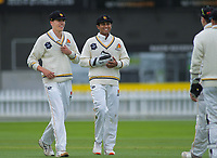 Wellington's Ben Sears and Rachin Ravindra on day one of the Plunket Shield cricket match between the Wellington Firebirds and Otago Volts at Basin Reserve in Wellington, New Zealand on Monday, 21 October 2019. Photo: Dave Lintott / lintottphoto.co.nz