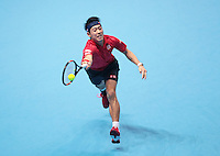 Kei Nishikori (JPN)(5) action against  Stan Wawrinka(SUI) (3) in their John McEnroe  Group  match during Day Two of the Barclays ATP World Tour Finals 2015 played at The O2 Arena, London on November 14th  2016