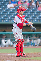 Hagerstown Suns catcher Spencer Kieboom (20) gives defensive signs during the game against the Greensboro Grasshoppers at NewBridge Bank Park on May 20, 2014 in Greensboro, North Carolina.  The Grasshoppers defeated the Suns 5-4. (Brian Westerholt/Four Seam Images)