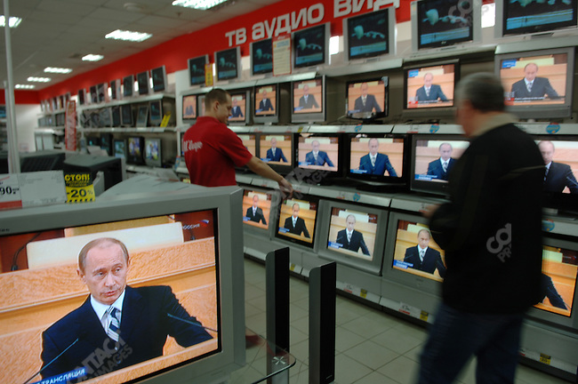 putinspeech05-PHOTO BY JAMES HILL/26 APRIL 2006-A customer was shown a television, one amongst the many in an electronics store in Moscow, which showed a live broadcast of President Vladimir Putin of Russia making his annual state of the nation address in the Kremlin to members of the Duma and Federation Council of the Russia.