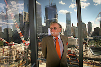 Tenth anniversary of 9/11.  Rebuilding at the World Trade Center site.  Developer and World Trade Center lease-holder, Larry A. Silverstein,   President and CEO of Silverstein Properties.  His 4 WTC is underconstruction directly behind him.   At left, construction proceeds on his 2 WTC.    Photo by Ari Mintz.  8/22/2011.