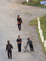 "North Koreans in the North Korean country-side. The DPRK (Democratic People's Republic of Korea) is the last great dictatorship where the people are bombarded with images of the ""Eternal President"" Kim Il-sung who died in 1994  and his son and current leader Kim Jong-il who are worshipped like a God."
