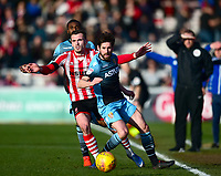 Lincoln City's Harry Toffolo vies for possession with Stevenage's Michael Timlin<br /> <br /> Photographer Andrew Vaughan/CameraSport<br /> <br /> The EFL Sky Bet League Two - Lincoln City v Stevenage - Saturday 16th February 2019 - Sincil Bank - Lincoln<br /> <br /> World Copyright © 2019 CameraSport. All rights reserved. 43 Linden Ave. Countesthorpe. Leicester. England. LE8 5PG - Tel: +44 (0) 116 277 4147 - admin@camerasport.com - www.camerasport.com