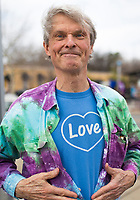 NWA Democrat-Gazette/CHARLIE KAIJO Bob Jordan of Fayetteville shows off his shirt during the Parade for Peace, Sunday, March 18, 2018 that started at the Walton Art Center and ended at the Town Center in Fayetteville. <br /><br />The Arkansas Poor People&acirc;&euro;&trade;s Campaign, the OMNI Center and Arkansas Nonviolence Alliance held a Parade for Peace. The parade featured multiple floats, dancing troops and large art projects.