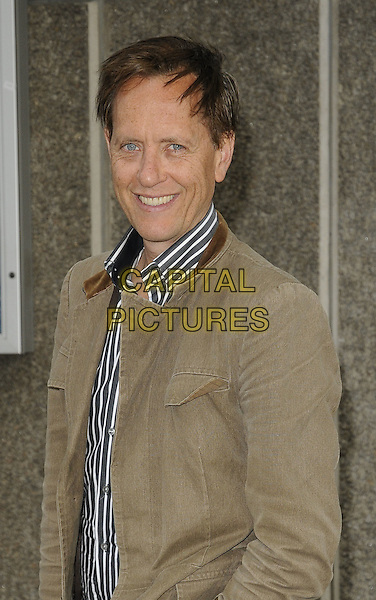 "RICHARD E. GRANT .At the ""Tracey Emin: Love Is What You Want"" Exhibition Opening Reception, Hayward Gallery, London, England, .16th May 2011..portrait headshot smiling  brown jacket  striped shirt .CAP/CAN.©Can Nguyen/Capital Pictures."