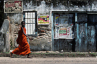 A Buddhist monk walks along the road in southern Sri Lanka near Galle in 1996.