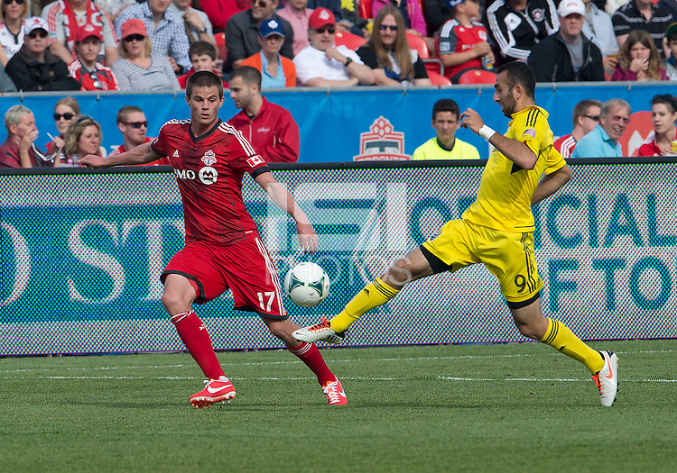 18 May 2013: Columbus Crew forward Justin Meram #9 and Toronto FC forward Justin Braun #17 in action during an MLS game between the Columbus Crew and Toronto FC at BMO Field in Toronto, Ontario Canada..The Columbus Crew won 1-0...