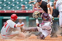 C.J. Cron #24 of the Utah Utes is tagged out at home plate by Kevin Gonzalez #10 of the Texas A&M Aggies at Minute Maid Park on March 4, 2011 in Houston, Texas.  Photo by Brian Westerholt / Four Seam Images