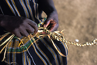 Pigmy woman weaving a rope