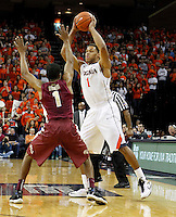 Virginia guard Justin Anderson (1) handles the ball next to Florida State guard Devon Bookert (1) during the second half of an NCAA basketball game Saturday Jan. 18, 2014 in Charlottesville, VA. Virginia defeated Florida State 78-66. (AP Photo/Andrew Shurtleff)