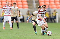 Houston, TX - Friday December 11, 2016: Drew Skundrich (12) of the Stanford Cardinal looks to pass the ball against the Wake Forest Demon Deacons at the NCAA Men's Soccer Finals at BBVA Compass Stadium in Houston Texas.