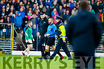 Referee William Harmon being escorted off the field at the end of the Kerry County Senior Football Final at Fitzgerald Stadium on Sunday.
