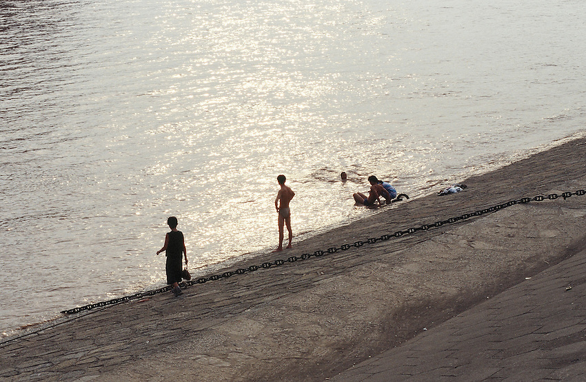 A swim at the sunset in the Yang-Zi river, near the great dam. China