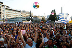 People attend a rally organized by supporters of the No vote in Athens. A new opinion poll shows a dead heat in Greece's referendum campaign with just two days to go before Sunday's vote on whether Greeks should accept more austerity in return for bailout loans.