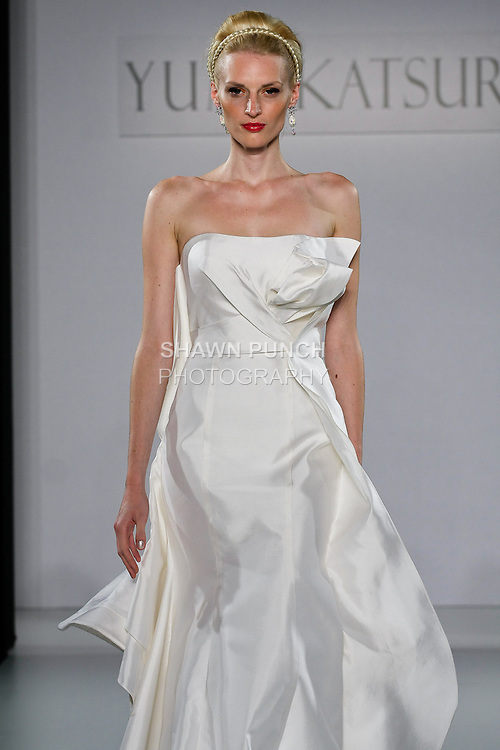 "Model walks runway in a Sendai wedding dress from the Yumi Katsura Fall 2013 ""Painting The World With Beauty"" bridal collection, during The Couture Show New York Bridal Fashion Week, October 14, 2012."