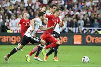 Sami Khedira und Jonas Hector (D) gegen Arkadiusz Milik (POL) - EM 2016: Deutschland vs. Polen, Gruppe C, 2. Spieltag, Stade de France, Saint Denis, Paris