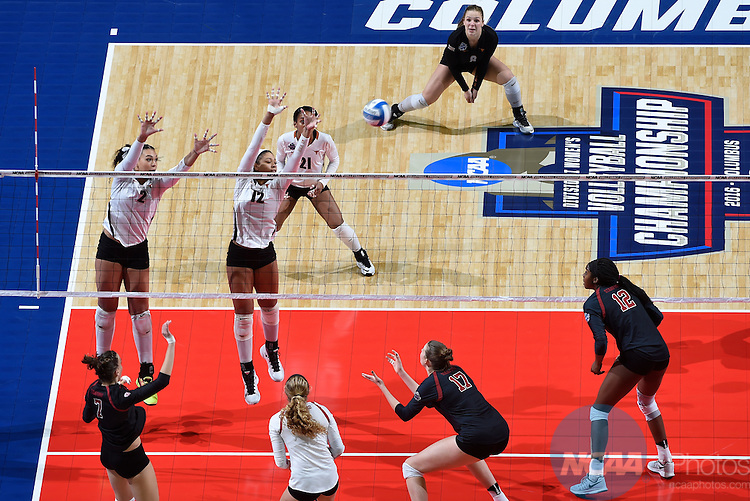 COLUMBUS, OH - DECEMBER 17:  Morgan Johnson (12) and Ebony Nwanebu (2) of the University of Texas attempt a block against Stanford University during the Division I Women's Volleyball Championship held at Nationwide Arena on December 17, 2016 in Columbus, Ohio.  Stanford defeated Texas 3-1 to win the national title. (Photo by Jamie Schwaberow/NCAA Photos via Getty Images)