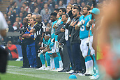 1st October 2017, Wembley Stadium, London, England; NFL International Series, Game Two; Miami Dolphins versus New Orleans Saints; Julius Thomas, Michael Thomas, Kenny Stills of the Miami Dolphins take a knee during the national anthem