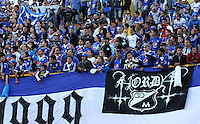 PASTO - COLOMBIA -16-02-2014: Los hinchas de Millonarios animan a su equipo durante partido de la quinta fecha de la Liga Postobon I 2014, jugado en el estadio Libertad de la ciudad de Pasto.  / The fans of Millonarios cheer for their team during a match for the fifth date of the Liga Postobon I 2014 at the Libertad stadium in Pasto city. Photo: VizzorImage  / Leonardo Castro / Str.