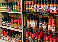 A variety of hot sauces in a specialty store, Helen, Georgia, USA.