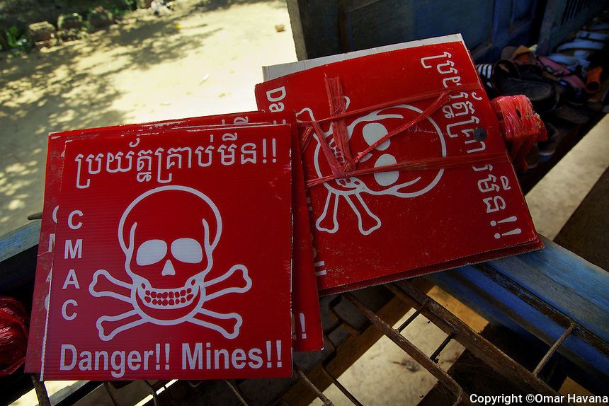 SVAY RIENG, CAMBODIA. Danger!! Mine Fields. Signs use by CMAC in Cambodia to alert residents of areas littered with landmines or UXOS. Photography: ©Omar Havana