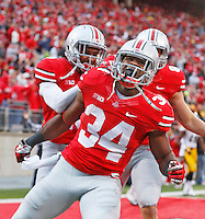 Ohio State Buckeyes running back Carlos Hyde (34) celebrates his diving TD against Iowa at Ohio Stadium on October 19, 2013.  (Chris Russell/Dispatch Photo)