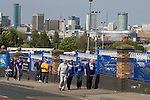 Fans walking up Cattall Road towards St. Andrew's stadium with the city's skyline in the distance, prior to Birmingham City's Barclay's Premier League match with Wolverhampton Wanderers. Both clubs were battling against relegation from  England's top division. The match ended in a 1-1 draw, watched by a crowd of 26,027.