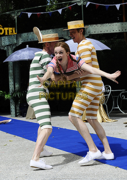 "LISA O'HARE .The ""Gigi"" photocall, Open Air Theatre, Regent's Park, London, England..August 12th, 2008.stage acting dress-up costume green yellow striped stripes costume lifting carrying mouth open funny gesture  braids plaits hands arms full length.CAP/CAN.©Can Nguyen/Capital Pictures."