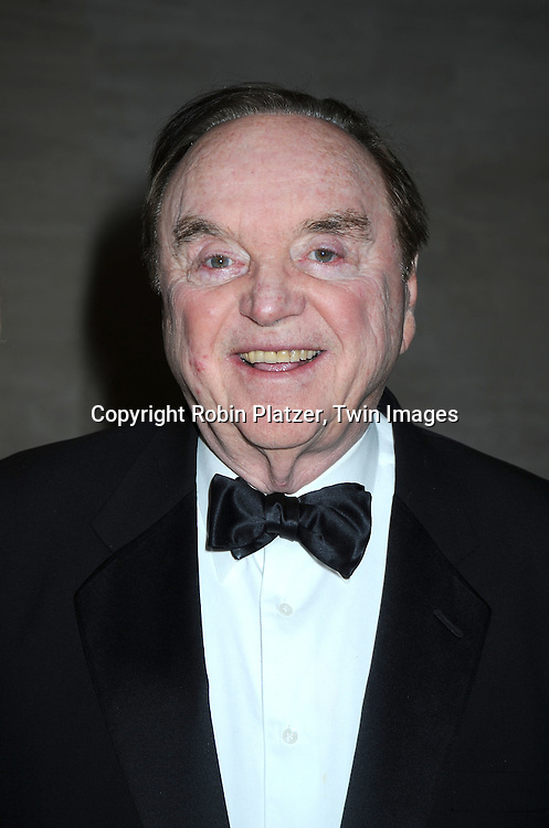 """Warren Adler posing for photographers at the 26th Annual Literacy Partners Gala with Star-Studded """"Evening of Readings""""  on May 10. 2010 at The Koch Theatre at Lincoln Center in New York City."""