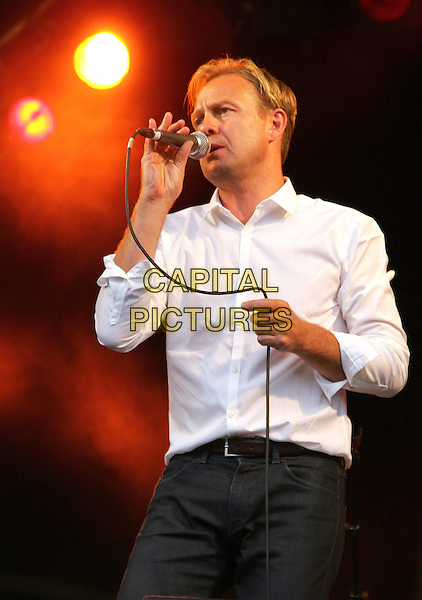 JASON DONOVAN .Performing live at Pop Picnic In The Park, Shuttleworth Park, Bedfordshire, England, UK, .August 21st 2010.half length music on stage concert gig show white shirt microphone singing jeans.CAP/JIL.©Jill Mayhew/Capital Pictures