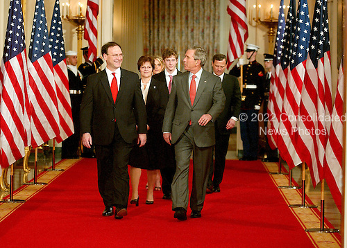 Washington, D.C. - February 1, 2006 -- Judge Samuel A. Alito, left, and his family are escorted to the East Room of the White House by United States President George W. Bush, right, for his sweraring-in as Associate Justice of the United States Supreme Court in Washington, D.C. on February 1, 2006..Credit: Ron Sachs / CNP